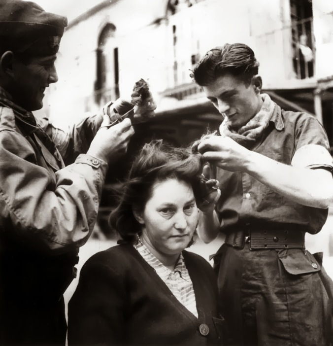 A French woman has her head shaved by civilians as a penalty for having consorted with German troops, 1944 6