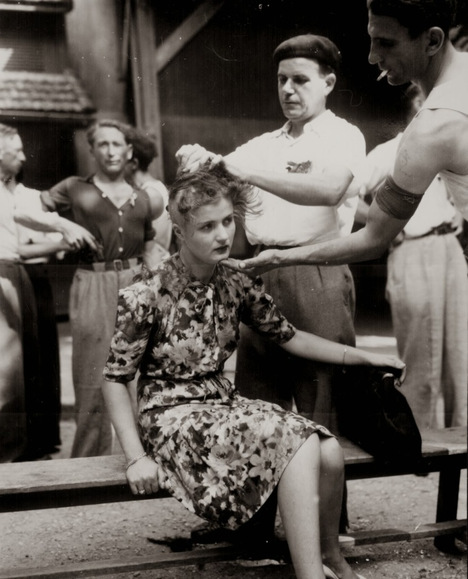 A French woman has her head shaved by civilians as a penalty for having consorted with German troops, 1944
