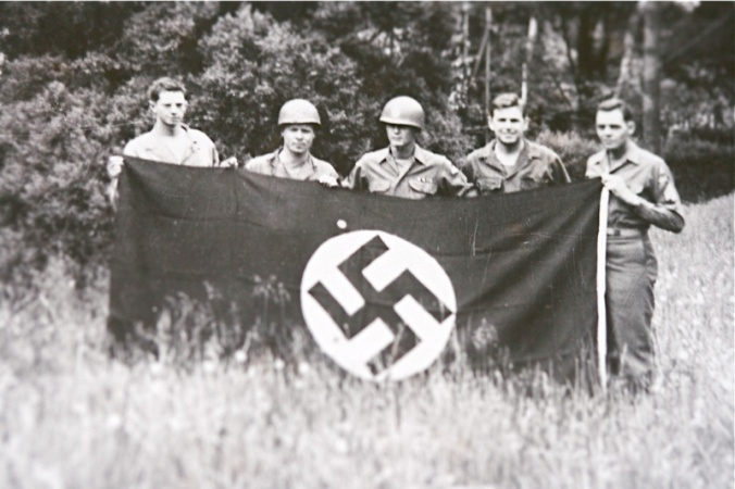 Amby (second from right) Holds a Captured German Flag in Leipzig
