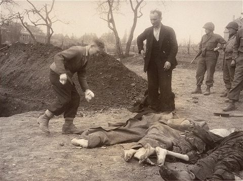 A Polish boy and his father bury the body of the boy's grandmother, who died in the Nordhausen c