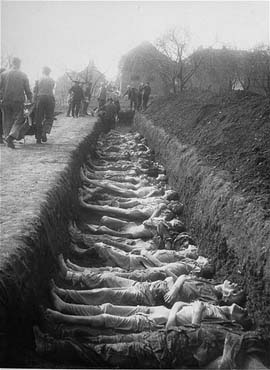 German civilians from the town of Nordhausen bury the bodies of former prisoners